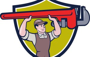Plumber Lifting Monkey Wrench Crest Cartoon